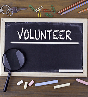 Volunteer On Chalkboard